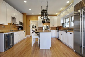 Kitchen in upscale home with gold colored walls